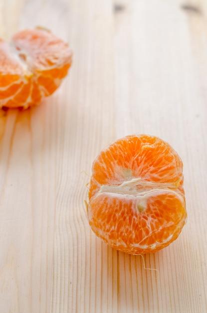 Piece of fresh orange on a wooden background Premium Photo