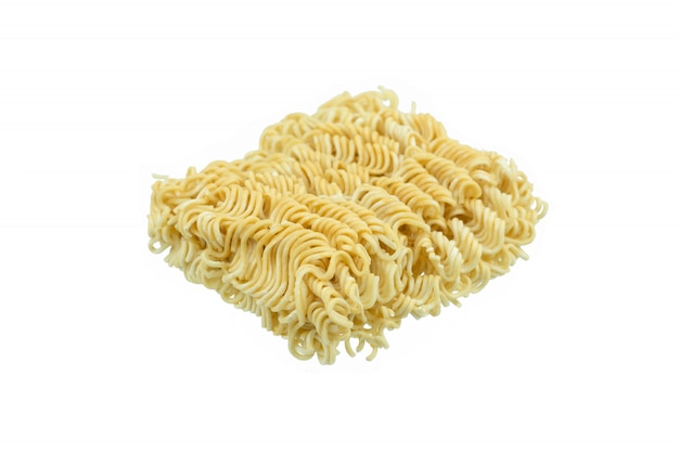Piece of instant noodles on paper isolated white background Premium Photo