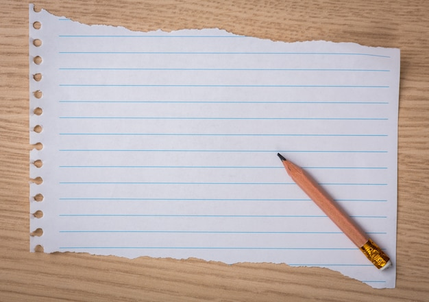 Piece Of Notebook Paper With A Pencil Photo  Free Download