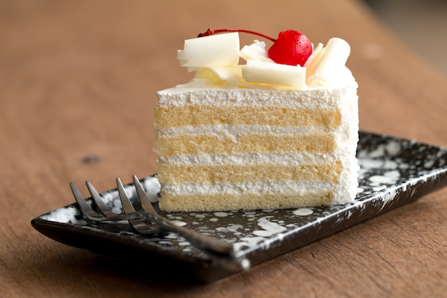 Piece Of White Cake With Vanilla Frosting And Cherry Jelly