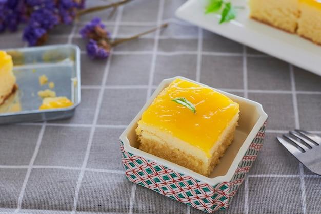 Piece of orange butter cake. Premium Photo