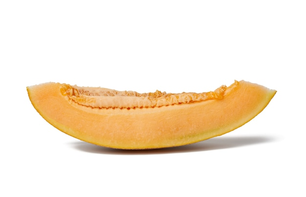 Piece of ripe melon with seeds, orange pulp, fruit isolated on white background, close up Premium Photo