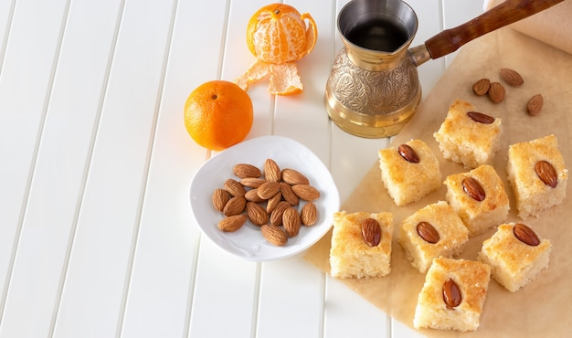 Pieces basbousa traditional arabic semolina cake with almond. Premium Photo