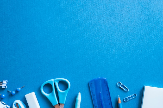 Pieces of essential blue stationery Free Photo