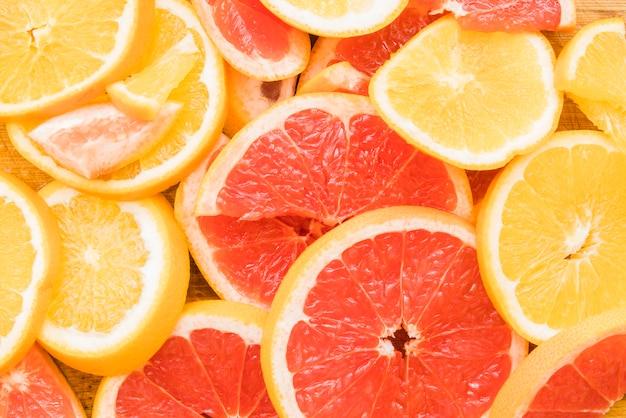Pieces of juicy citrus fruits Free Photo