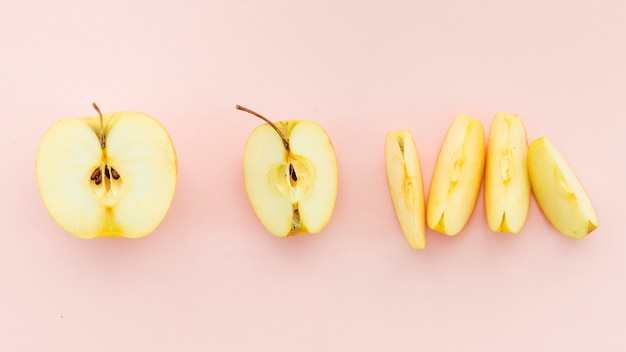 Pieces of ripe delicious yellow apple Free Photo