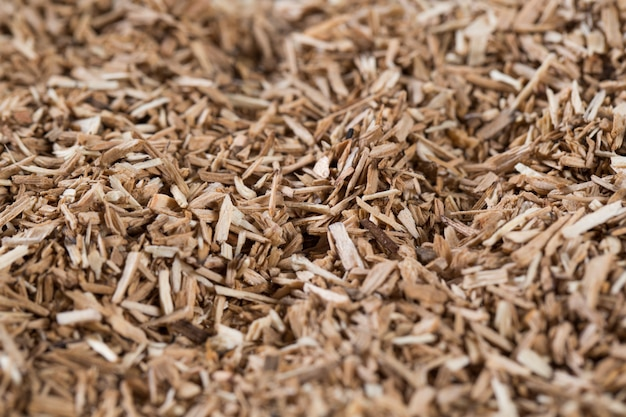 Pieces of wood chip smoking element giving flavor and taste many elements pattern natural beige. Premium Photo