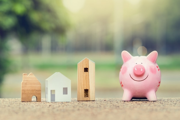 Piggy bank and house model for finance and banking concept Premium Photo