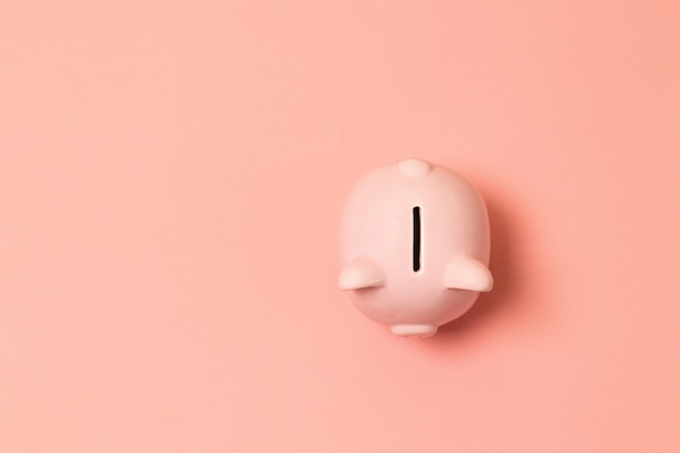 Piggy bank on living coral background. commercial concept. Premium Photo