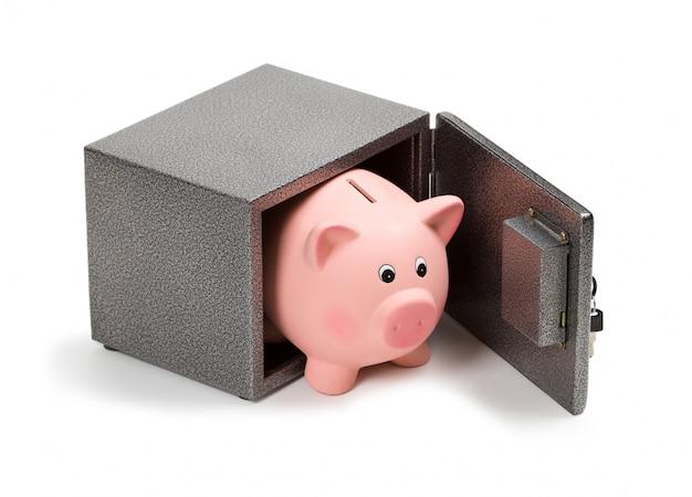 Piggy bank in a safe Premium Photo