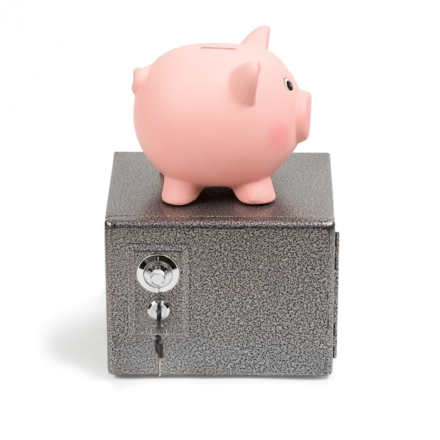 Piggy bank standing on a safe Premium Photo