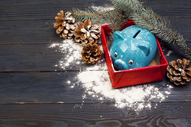 Piggy bank with christmas decoration background. Premium Photo