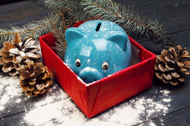 Piggy bank with christmas decoration. christmas composition. Premium Photo