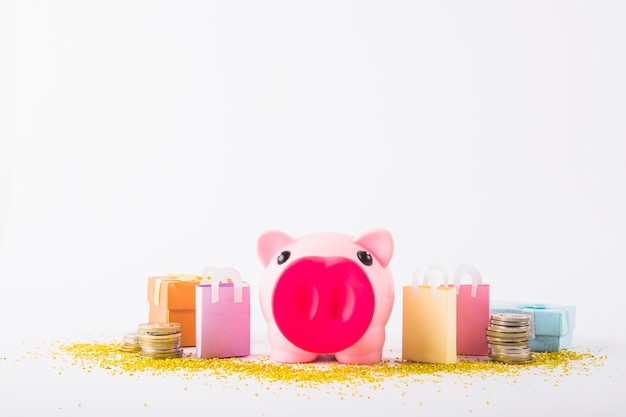 Piggy bank with paper bags Free Photo