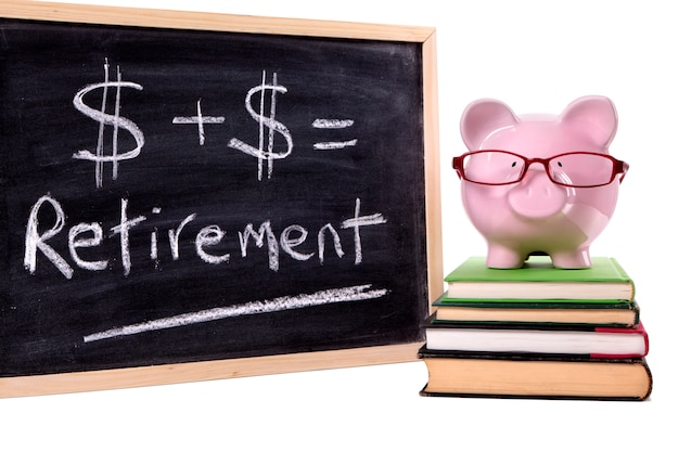 Piggy bank with retirement calculation Free Photo