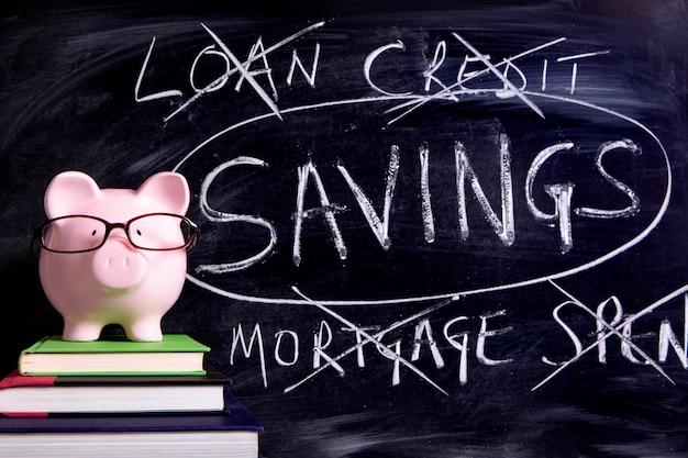 Piggy bank with savings message Premium Photo