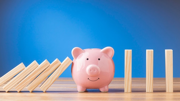 Piggy bank with wooden pieces arrangement Free Photo