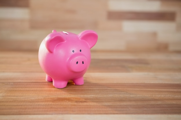 Piggy bank on wooden surface Free Photo