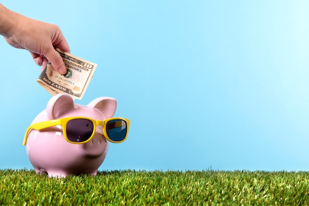 Piggybank with yellow sunglasses Free Photo