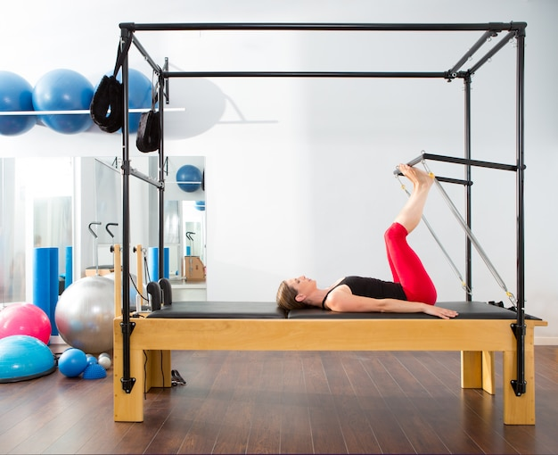 Pilates aerobic instructor woman in cadillac Premium Photo