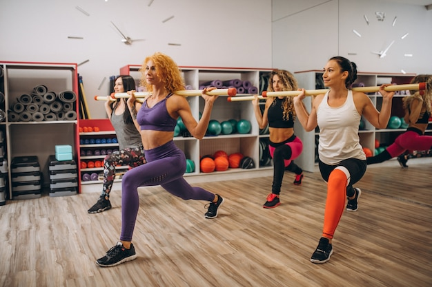 Pilates group working out in a gym Free Photo