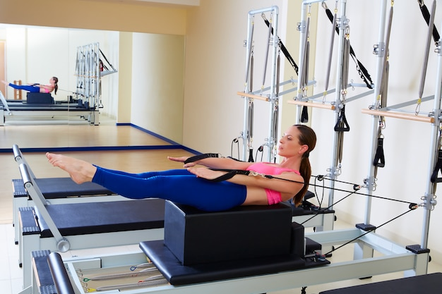 Pilates reformer woman back stroke exercise Premium Photo