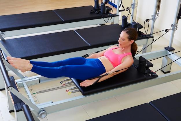 Pilates reformer woman hundred exercise Premium Photo
