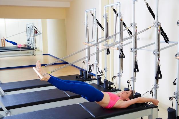 Pilates reformer woman long spine exercise Premium Photo