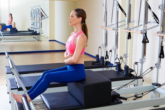 Pilates reformer woman short box exercise Premium Photo