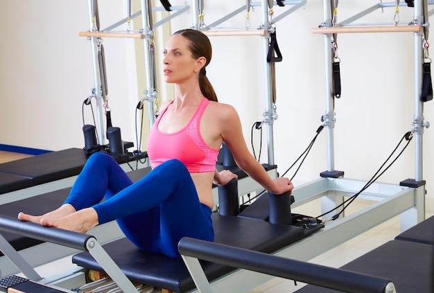 Pilates reformer woman stomach massage flat Premium Photo