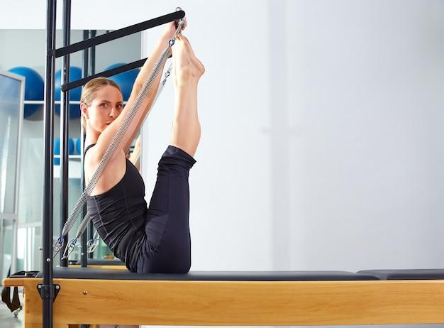 Pilates woman in reformer monki exercise Premium Photo
