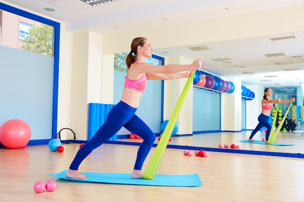 Pilates woman standing rubber band exercise Premium Photo