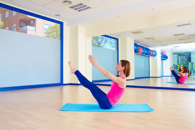 Pilates woman teaser exercise workout at gym Premium Photo