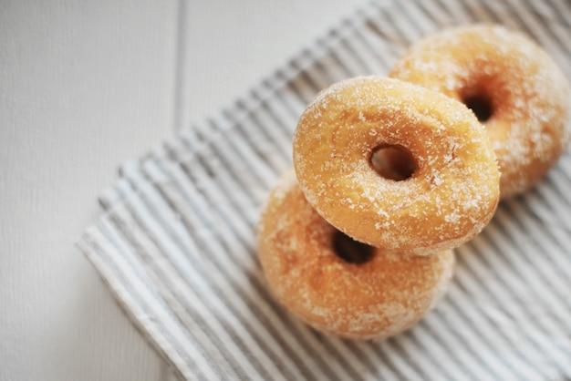 Pile of american doughnut on  towel Free Photo