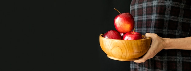 Pile of apples in a bowl copy space Free Photo