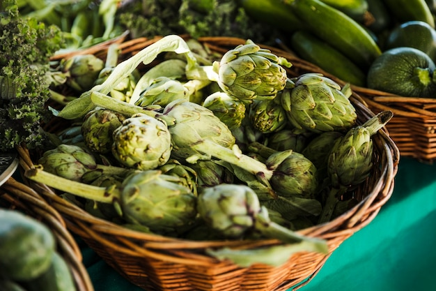 Pile of artichoke on display at farmers market Free Photo