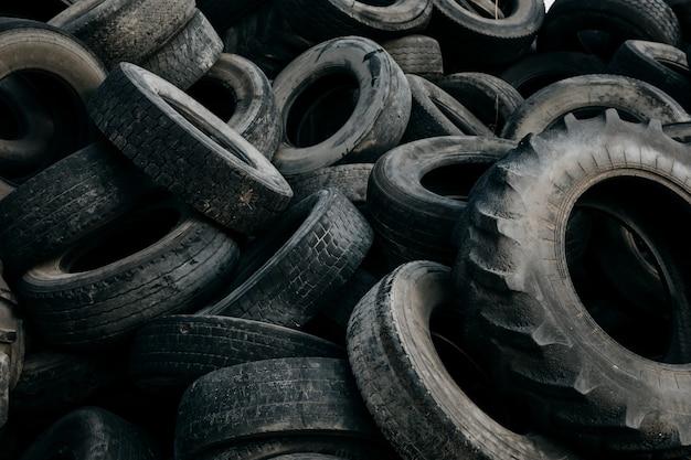 Pile of big used tires at a dump Premium Photo