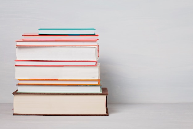 Pile of books on the table. leisure, reading, study concept Premium Photo