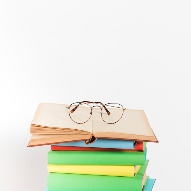 Pile of books with glasses Free Photo
