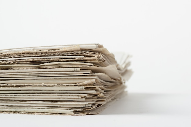 Pile of business papers on white wall Premium Photo