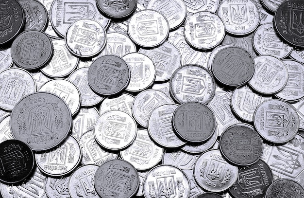 A pile of coins ukrainian Premium Photo