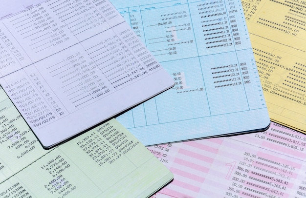 Pile of colorful bank account passbook for background, account and saving concept Premium Photo