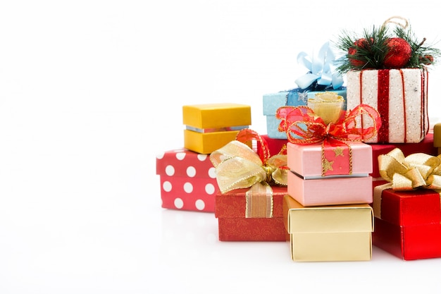 Pile of colorful gift boxes isolated on white Premium Photo