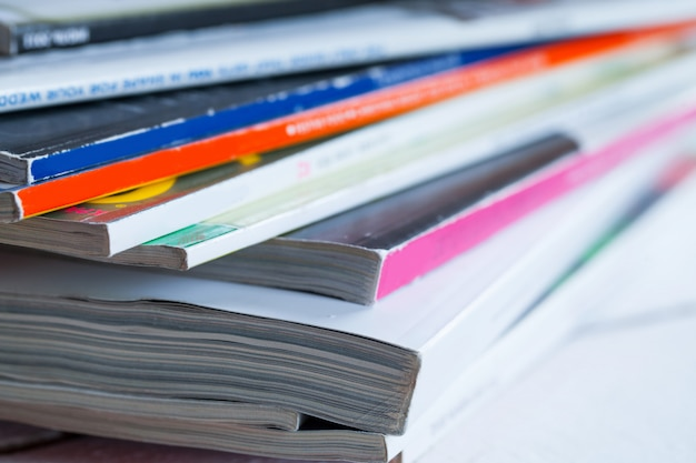 Pile of colorful magazines on a table Free Photo