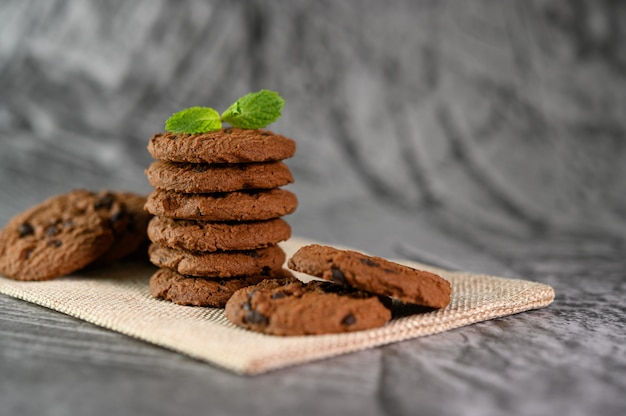 A pile of cookies on a cloth on a wooden table Free Photo