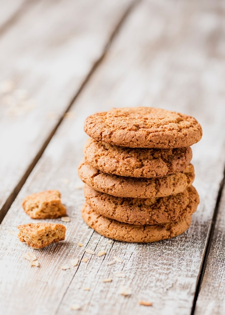 Pile of cookies on wooden background Free Photo