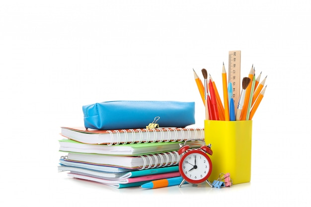 Pile of copybooks and stationery isolated on white Premium Photo