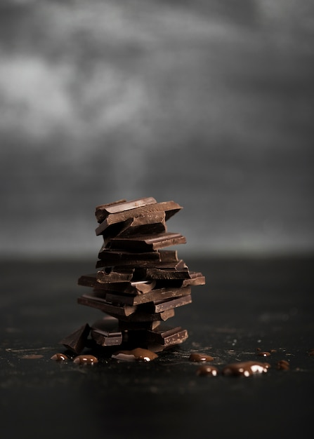 Pile of delicious milk chocolate and blurred background Free Photo