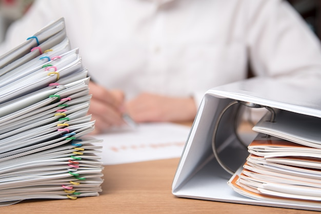 A pile of documents with the man in the document. Premium Photo