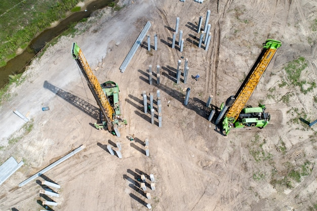 Pile driving work at construction site Premium Photo